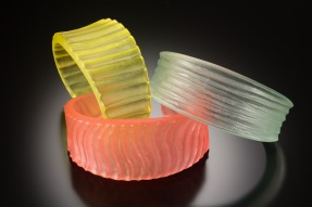 acrylite cuffs - various colors/carved textures also available