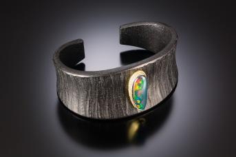 Acrylite jet; 18k; boulder opal